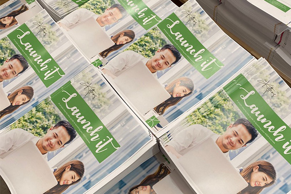 Brochures ready to be picked, packed and sent by Express Print & Mail